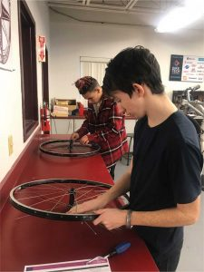 Riley and Jan rebuild wheels